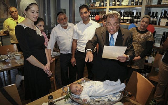 Rabbi Shlomo Riskin, rabbi of the Jewish settlement of Efrat, conducts the pidyon haben ceremony for a 30-day-old first-born son in Efrat last month. (Photo by Gershon Elinson/Flash90)