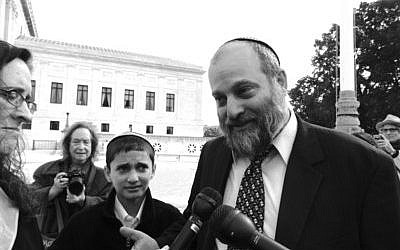 Ari Zivotofsky and his son, Menachem, spoke to reporters after the Supreme Court decision on their case. (Photo provided)