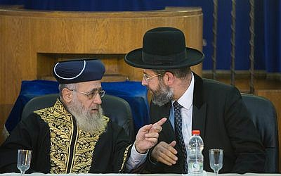 Sephardic Chief Rabbi of Israel Yitzchak Yosef (left) and Ashkenazi Chief Rabbi of Israel David Lau speak at a rabbinic ordination ceremony of the Israeli Chief Rabbinate in Jerusalem last year. Yosef recently issued a call to action for the Sephardic Jewish community to join Ashkenazim in embracing premarriage genetic testing. (Photo by Yonatan Sindel/Flash90)