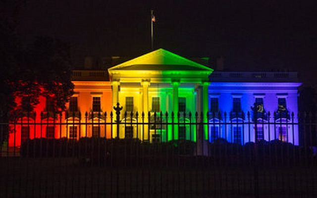 The White House is lit up in rainbow colors in recognition of the U.S. Supreme Court's ruling that legalized same-sex marriage nationwide. (Photo by Jeff Malet)