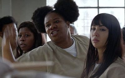 "Cindy, played by Adrienne C. Moore (center), and Flaca (right), played by Jackie Cruz,  in ""Orange Is the New Black."" (Photo provided by Netflix)"
