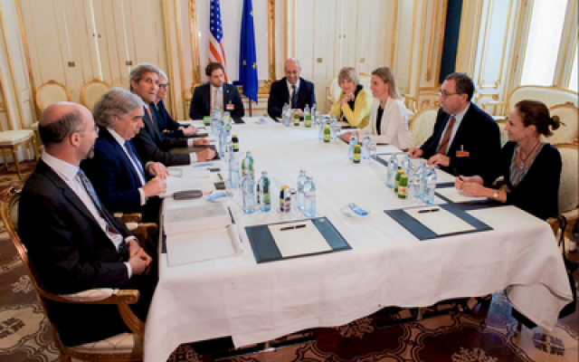 Secretary of State Kerry, Iranian Foreign Minister Zarif and their respective teams sit together amid Iranian nuclear program negotiations in Austria. (Photo provided by U.S. Department of State)