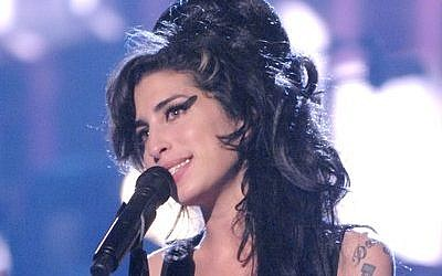 "Amy Winehouse performs ""Rehab"" during the 2007 MTV Movie Awards at Gibson Amphitheater in Los Angeles. (Photo provided by JTA)"