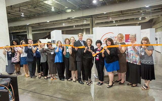 "Educators gather to cut the ribbon for the David L. Lawrence Convention Center's latest exhibit, ""The Wonders of Learning: The Hundred Languages of Children."" (Photo by Jennifer Highfield)"