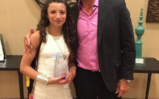 Jim Skirboll, Maccabi USA swim coach, shares a happy moment with daughter Zoe, who set two national swim records this past year. (Photo provided by Jim Skirboll)