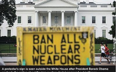 A protestor's sign is seen outside the White House after President Barack Obama spoke to the nation about the Iran nuclear deal, hammered out in Vienna. (Photo by Jim Lo Scalzo/EPA)