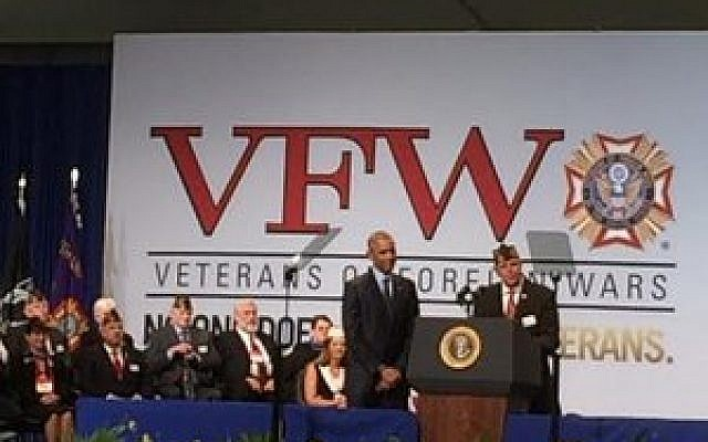 VFW National Commander John W. Stroud introduces President Barack Obama at the David L. Lawrence Convention Center. (Photo by Toby Tabachnick)