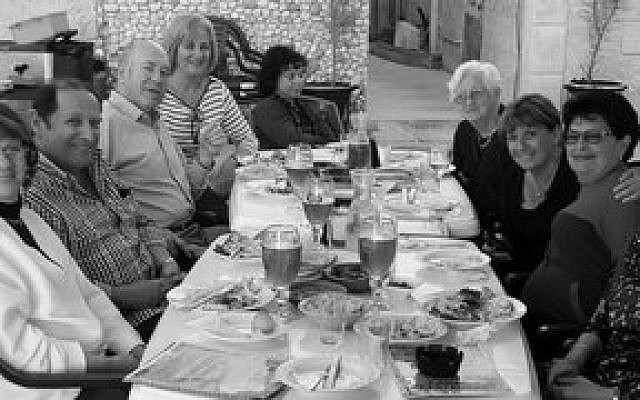 A family together, from left: Idit Kronberger, Oscar Hartstein, Yehuda Fixler and wife Ruth Fixler, Sara Sagiv, Eva Prince-Por, Judy Feig Berkowitz, Dr. Edit Hartstein-Feinstein and Marta Hartstein. (Photo provided by Judy Berkowitz)