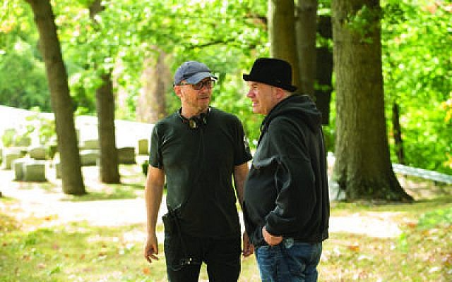 "David Simon (right) talks with director Paul Haggis on the set of Simon's new HBO series ""Show Me a Hero."" (Photo courtesy of HBO)"