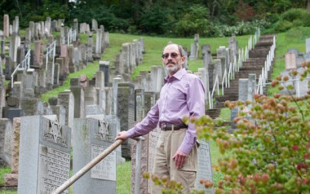President of the JCBA Jonathan Schachter looks over the Machsikei Hadas Cemetery. Schachter ensures the maintenance of many of the Pittsburgh-area Jewish Cemeteries. (Photo by Lindsay Dill)