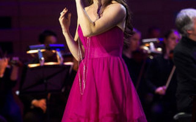 Idina Menzel's versatility was showcased in a concert that at times had a party flavor. (Photo by Robin Wong)