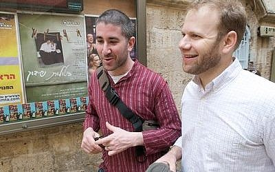 Michael Solomonov and Steven Cook talk about recipes and food while walking through the streets of Israel. (Photo provided by Zahav)