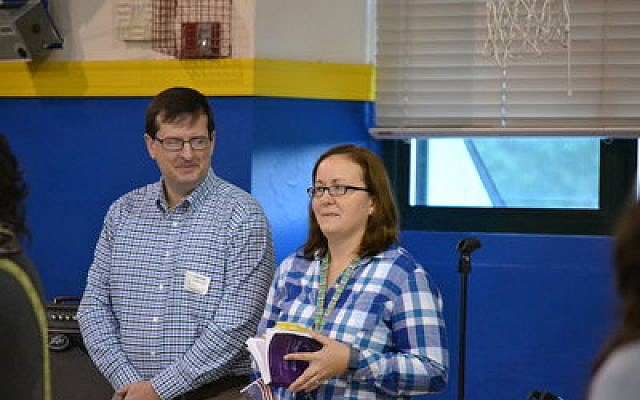 Kyle Ison and her husband, Lawrence, listen to the many CDS tributes. (Photo provided by Community Day School)