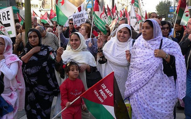 Demonstrators in Madrid march in support of Western Sahara's self-determination in 2006. (Photo by Wikimedia Commons)