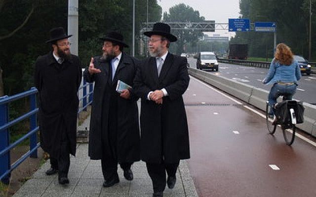 Dutch rabbis discuss the planned refugee center in the Amsterdam suburb of Buitenveldert, which will house migrants from the Middle East. (Photo by David Serphos)