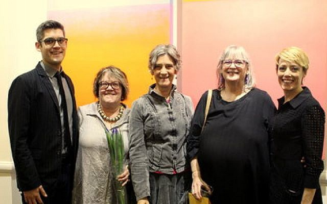 Standing in front of one of the artist's works, from left: Micah Haskell-Hoehl, the artist's grandson; Vicky Clark, an exhibit curator; Patti Haskell and Judi Haskell, daughters of the artist; and Melissa Hiller, an exhibit curator and director of the American Jewish Museum. (Photo by Simone Shapiro)