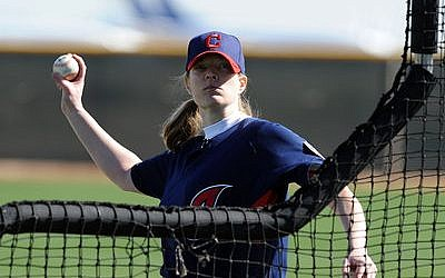 Justine Siegal, prior to coaching for the Athletics, made baseball history in 2011 by throwing batting practice for the Indians. (Photo by Norm Hall/Getty Images)