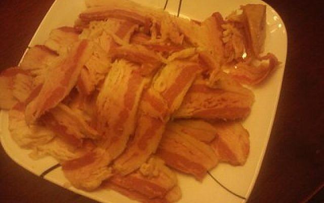 Bacon after curing, smoking and slicing. (Photo provided by Avi Avishai)
