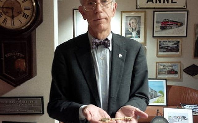 Henry Posner III holds his key to the city of Rock Island, Ill. (Photo by Adam Reinherz)
