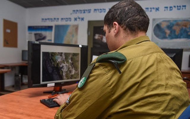 A soldier in Roim Rachok, Hebrew for Seeing Far, an Israeli army program aimed at drafting people with autism. (Photo courtesy of the Israel Defense Forces)