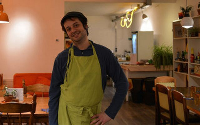 """Yuval Gal, at his hummus restaurant in The Hague, describes his food as """"Palestinian green cuisine."""" (Photo Courtesy of Love & Peas)"""