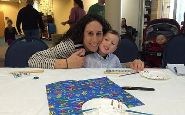 Erin and Riley Herman have fun making a menorah at the South Hills JCC on Sunday. (Photo provided by South Hills Jewish Pittsburgh)