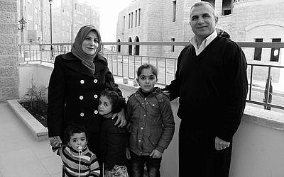 The family of Basim Dodin and his wife, Asma, are among the first Palestinian residents of Rawabi.