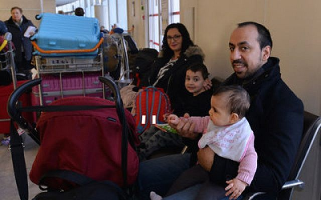 Rudy Abecassis and his family wait at Charles de Gaulle Airport in December as they prepare to fly to Israel.  Photo by Cnaan Liphshiz