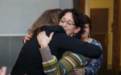 Eileen Freedman (right) is congratulated by CDS head of school Avi Baran Munro. (Photo courtesy of Community Day School)