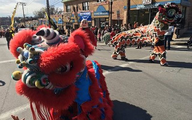 Colorful lions make their way through Squirrel Hill as part of the Lunar New Year Parade.  Photo by Jim Busis