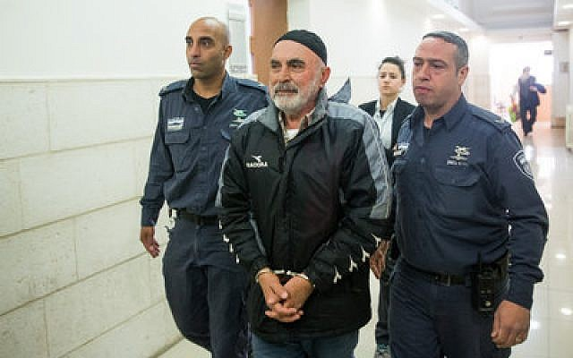 Ezra Nawi is brought into Jerusalem District Court on Jan. 21. He was arrested after a broadcast of an Israeli investigative program.   Photo by Yonatan Sindel/Flash9