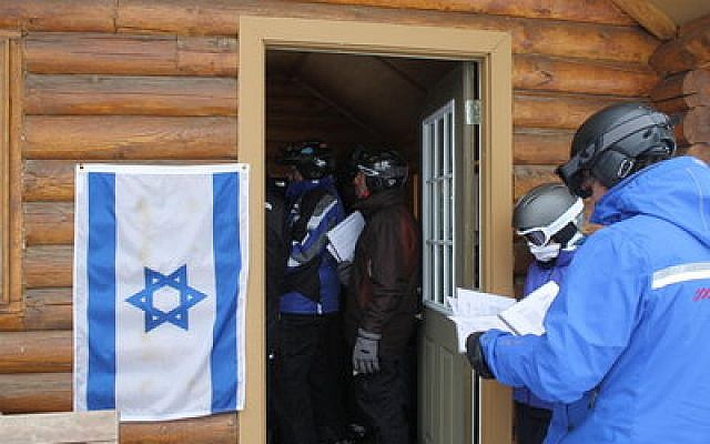 An Israeli flag is posted at Deer Valley's Sunset Cabin every Friday afternoon to alert skiers to the weekly Kabbalat Shabbat service.   Photo by Uriel Heilman