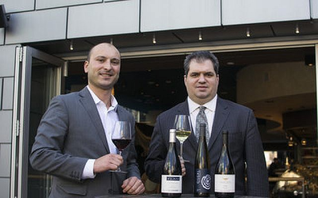 "Nicholas Rizzo (left), general manager of Poros, and Alan Uchrinscko, assistant general manager and sommelier, say the Israeli wines featured at Poros are ""selling well.""  Photo provided by Poros"