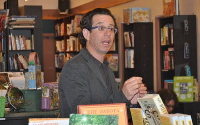 "Assaf Gavron discusses his novel ""The Hilltop"" and answers questions regarding Israeli policies at Classic Lines Bookstore in Squirrel Hill.   Photo by Adam Reinherz"