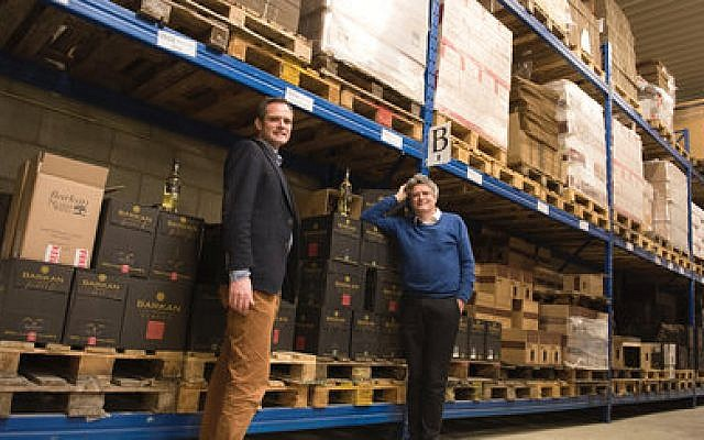 Pieter van Oordt (left) with his brother, Roger, take pride in their Israel Products Center in Nijkerk, the Netherlands.  Photo by Cnaan Liphshiz