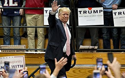 Republican presidential hopeful Donald Trump waves  to the crowd at a rally in Concord, N.C.   Photo by Sean Rayford/Getty Images