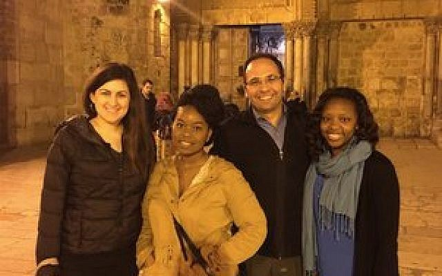 From left: Paige Creo, India Wilson, Arab entepreneur Ala Sader and Tamika Riley pose for a photo in front of the Church of the Holy Sepulchre. Photo provided by Paul Harper