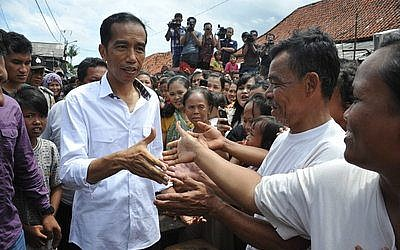 Indonesian President Joko Widodo greets supporters in Jakarta, the country's capital.   Photo by Jokowi Blusukan via Wikimedia Commons.