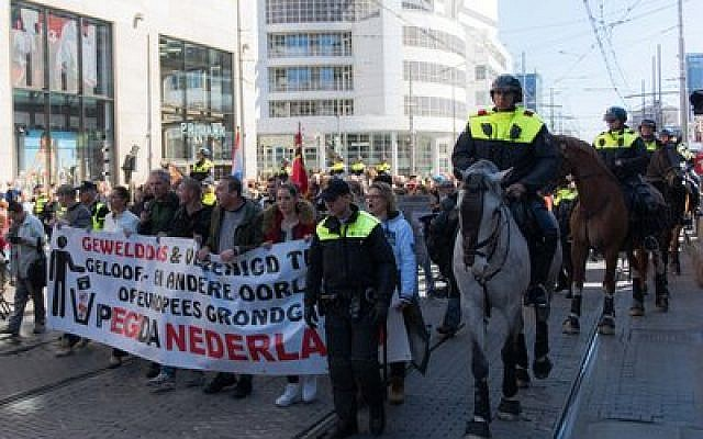Demonstrators protest against the arrival of Muslim immigrants to Europe in The Hague, Netherlands.   Photo by Cnaan Liphshiz