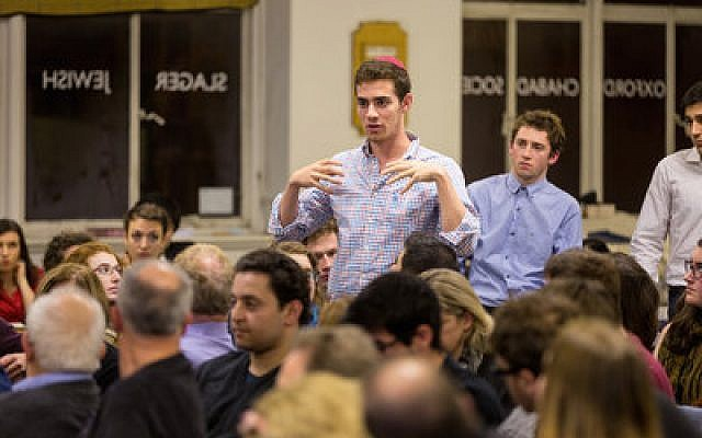 A Jewish student makes his point during a debate featuring Alan Dershowitz at Oxford's Chabad Centre last November.   Photo courtesy of Chabad Lubavitch World Headquarters