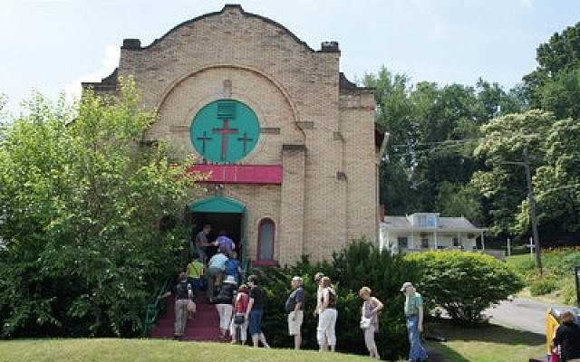 The tour group files into the former Tree of Life synagogue building in  Ellwood City. Photo by Tammy Hepps