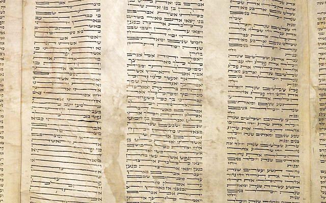 While rolling Temple B'nai Israel's Torah scroll, Rabbi Paul Tuchman noticed historically unusual handwriting in the left column.Photo by Adam Reinherz
