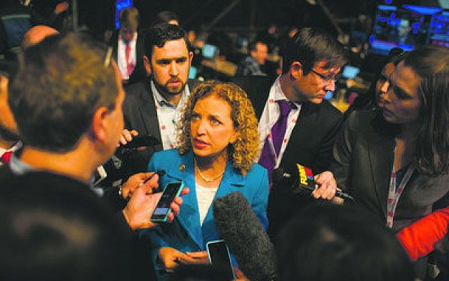Florida Rep. Debbie Wasserman Schultz, chairwoman of the Democratic National Committee, speaks with reporters after a presidential debate last month in New York.   Photo by Stephen Shames/Polaris