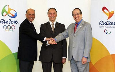 The Jewish trio in charge of the Rio Olympics. Carlos Arthur Nuzman is flanked by Sidney Levy (left) and Leonardo Gryner in 2012.   Photo by Marcio Rodrigues