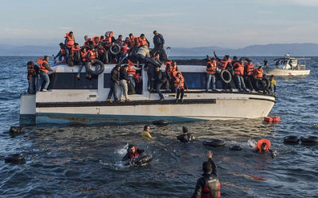 Syrian and Iraqi migrants arrive at the Greek island of Lesbos on Oct. 30, 2015.   Photo by Ggia via Wikimedia Commons