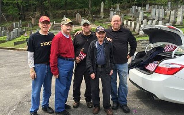 The JWV volunteers at Tiphereth Israel Cemetery are (from left) Dick Silk, Bill Aronson, Jerry Stalinsky, Jake Notovitz, and  Burt Hochhauser. Photo by Tammy Hepps