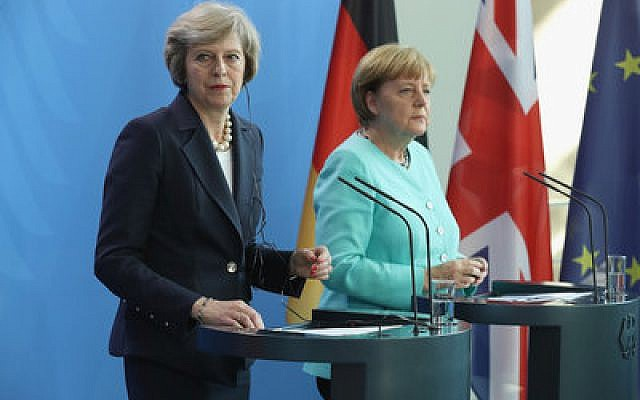 British Prime Minister Theresa May (left) and German Chancellor Angela Merkel speak to the media following talks at the Chancellery in Berlin last week.  Photo by Sean Gallup/Getty Images