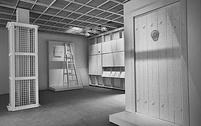 "The interior of ""The Evidence Room"" at the Venice Architecture Biennale, with models of an Auschwitz gas column, a gas-tight hatch and a gas-tight door. (Fred Hunsberger)"