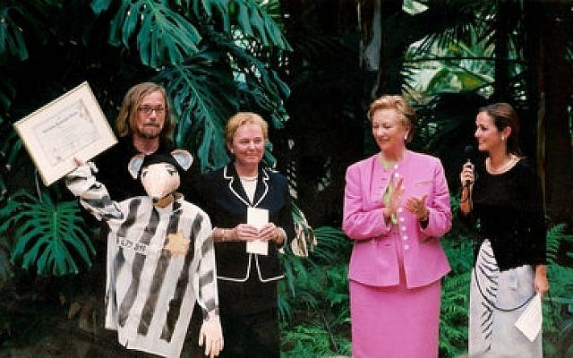 "Luc Descheemaeker (left), receives an award from Belgium's Queen Paola in 2002 for his children's puppet theater play based on Art Spiegelman's cartoon memoir ""Maus.""   Photo courtesy of Sint-Jozefs Institute"