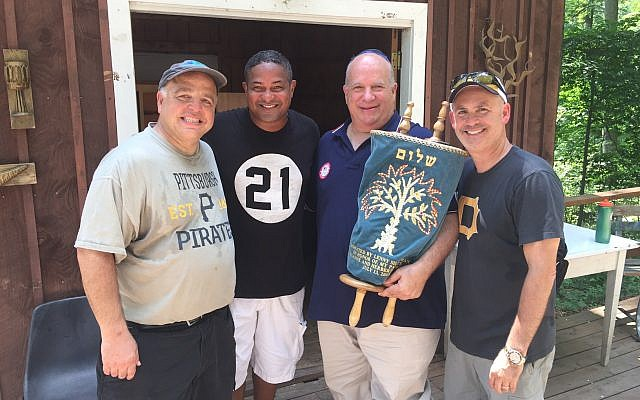 From left: Bobby Harris, Roberto Clemente Jr., Lenny Silberman and Jeff Solomon, who all traveled to EKC to impart the lessons of Roberto Clemente.    Photo courtesy of Lenny Silberman